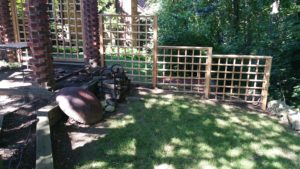 Our own crafted cedar lattice style fence stair stepped